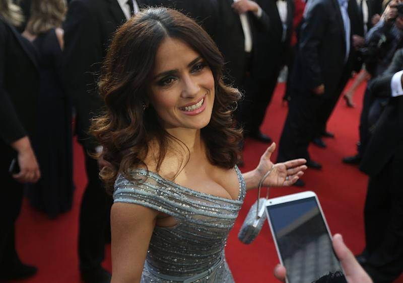 """Lebanese-Mexican actress Salma Hayek talks to the press as she walks the red carpet to launch the global premiere of her animated adaptation of Kahlil Gibran's celebrated novel """"The Prophet"""" in the Lebanese capital Beirut, on April 27, 2015 (AFP Photo/Joseph Eid)"""