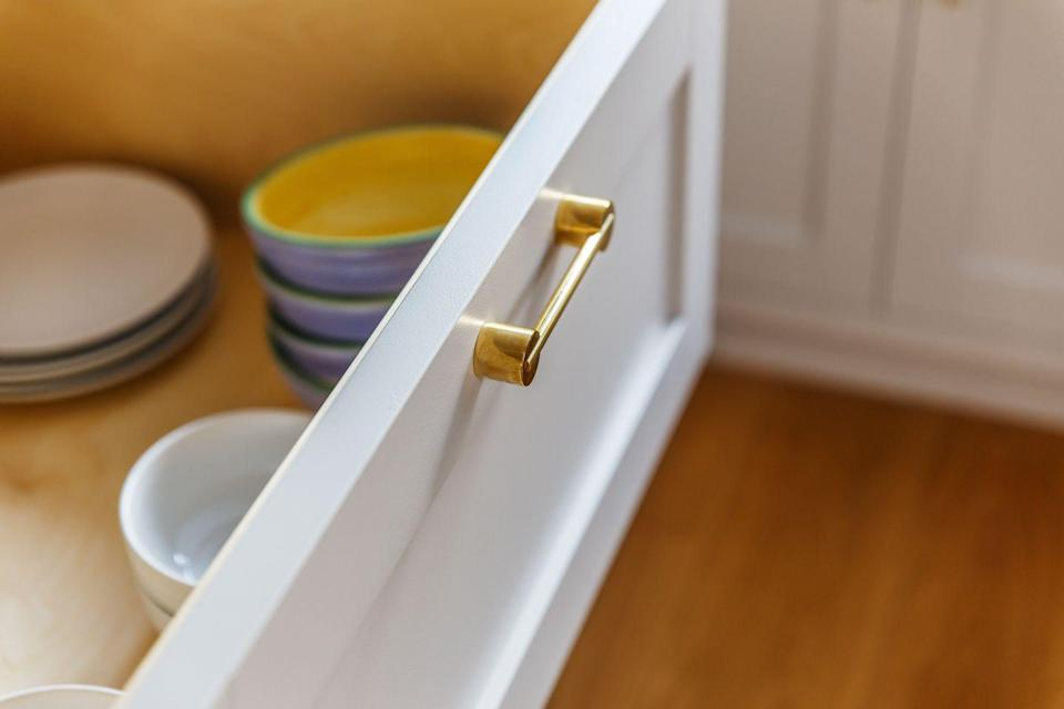 """<p>It may be only a small touch, but upgrading your cabinet handles can alter the whole feel of a kitchen. Look out for quirky designs in smart metallic finishes, or bold shapes in unexpected colourways.</p><p>Pictured: Myford handle, <a href=""""https://swarfhardware.co.uk/"""" rel=""""nofollow noopener"""" target=""""_blank"""" data-ylk=""""slk:Swarf"""" class=""""link rapid-noclick-resp"""">Swarf</a></p>"""