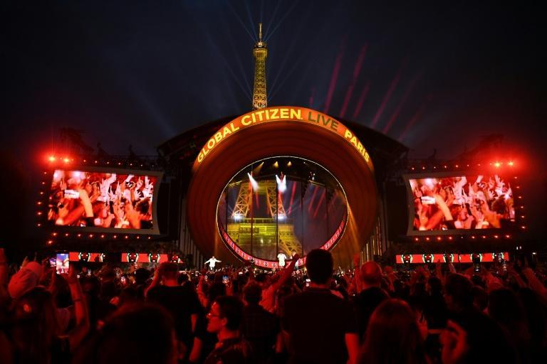 Macron's announcement came in a video broadcast during the Paris leg of the Global Citizen Live concert (AFP/bertrand GUAY)