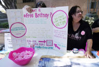 Britney Spears supporters Jan Simmons, right, of Detroit, and her daughter Leanne set up a table outside a court hearing concerning the pop singer's conservatorship at the Stanley Mosk Courthouse, Wednesday, June 23, 2021, in Los Angeles. (AP Photo/Chris Pizzello)