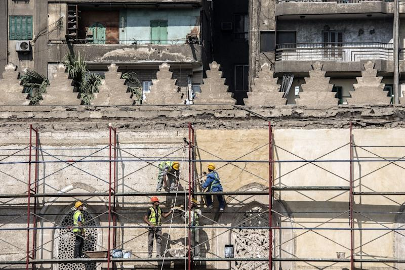 Work on Cairo's 13th-century al-Zahir Baybars mosque in the neglected Islamic quarter resumed last month after being halted during the turmoil that followed the ouster of the dictator Hosni Mubarak in 2011 (AFP Photo/Khaled DESOUKI)