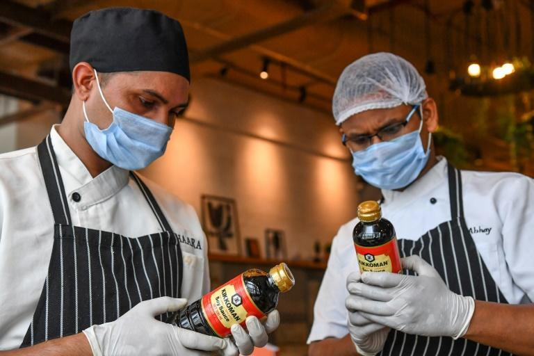 Kikkoman hopes its move to market soy sauce in India will strike a chord in a country where culinary innovation is part of street food culture (AFP/Indranil MUKHERJEE)