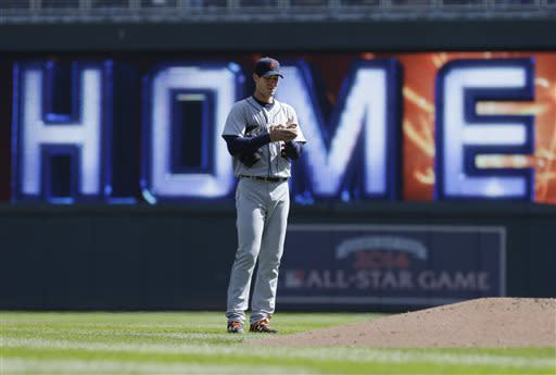 Detroit Tigers pitcher Rick Porcello looks at the ball after giving up a 2-run home run to Minnesota Twins' Josh Willingham in the third inning of a baseball game, Thursday, April 4, 2013, in Minneapolis. (AP Photo/Jim Mone)