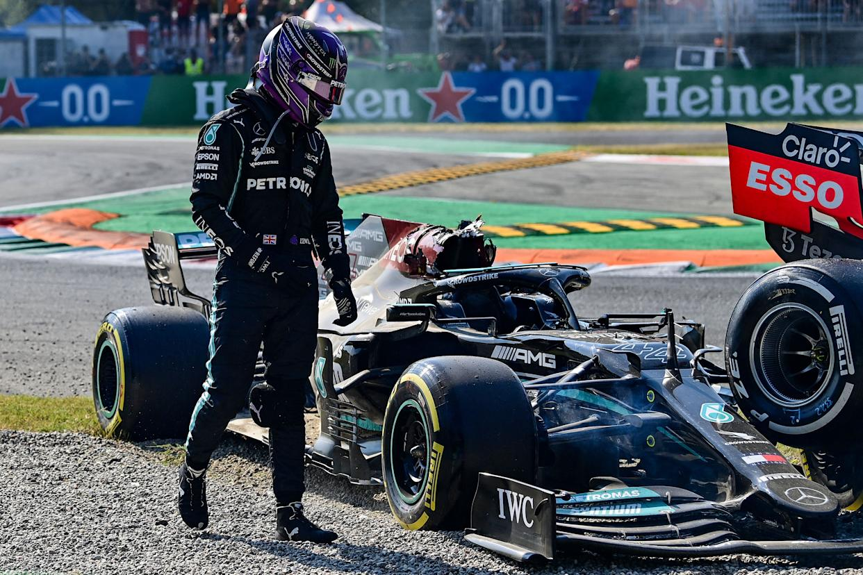 Lewis Hamilton gets out of his car following a collision with Max Verstappen.