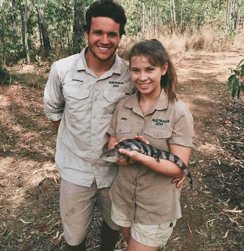 Chandler Powell and Bindi Irwin hold Australian lizard in the iconic Steve Irwin khaki on the croc tour in 2016