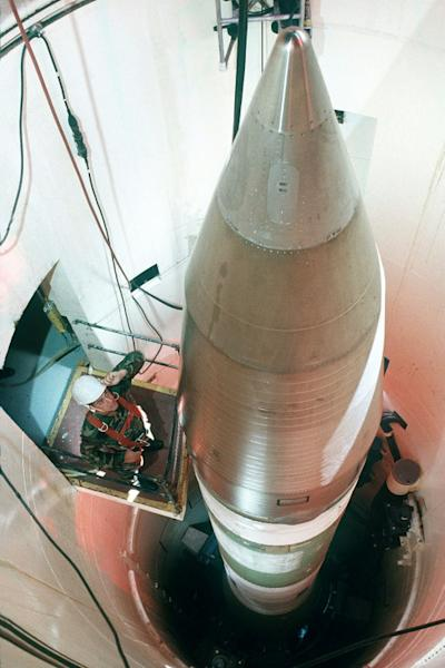 An Air Force technician inspecting an LGM-30G Minuteman III nuclear missile inside a silo about 60 miles from Grand Forks Air Force Base, in North Dakota