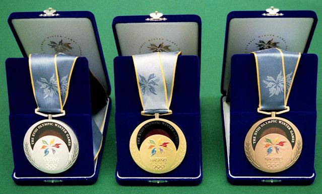 Silver, gold and bronze (from left) medals of the 1998 Nagano Winter Olympic Games are unveiled to the media at the Mint of the Finance Ministry in Osaka, western Japan, Tuesday, Sept. 9, 1997. (AP Photo/Kyodo News)