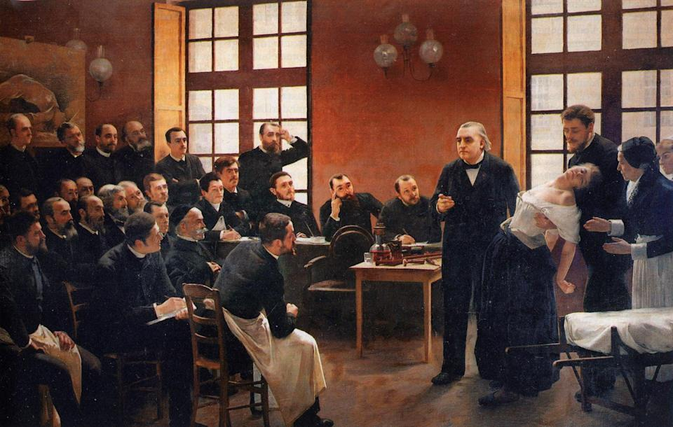 Jean-Martin Charcot presents a half-dressed woman to demonstrate hysteria to a group of men in 'A Clinical Lesson at the Salpêtrière' by  André Brouillet (1887) (Paris Descartes University, Paris)