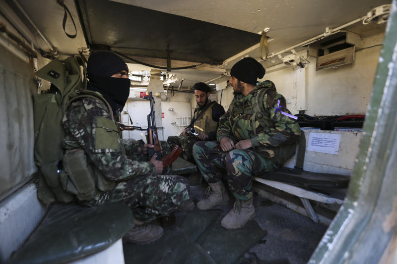Turkish backed rebel fighters prepare for an attack near the village of Neirab in Idlib province, Syria, Thursday, Feb. 20, 2020. Two Turkish soldiers were killed Thursday by an airstrike in northwestern Syria, according to Turkey's Defense Ministry, following a large-scale attack by Ankara-backed opposition forces that targeted Syrian government troops. (AP Photo/Ghaith Alsayed)
