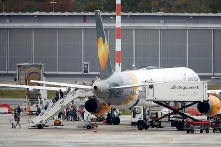 Passengers disembark a Boeing 757-300 of Condor Airlines after landing at Duesseldorf Airport