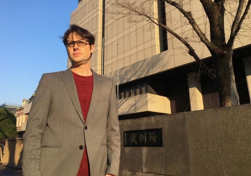 Scott McIntyre, an Australian sports journalist, poses for a photograph before his sentencing outside Tokyo District Court in Tokyo