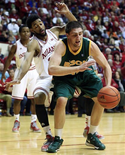 North Dakota State's Marshall Bjorklund, right, is fouled by Indiana's Christian Watford during the first half of an NCAA college basketball game, Monday, Nov. 12, 2012, in Bloomington, Ind. (AP Photo/Darron Cummings)