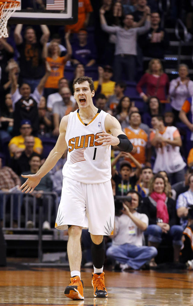 Phoenix Suns' Goran Dragic, of Slovenia, shouts in celebration after making a 3-point shot against the Golden State Warriors during the second half of an NBA basketball game Saturday, Feb. 8, 2014, in Phoenix. The Suns won 122-109. (AP Photo/Ross D. Franklin)