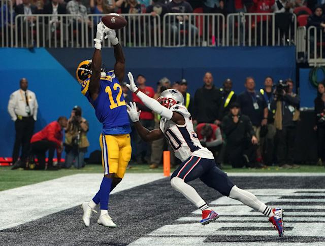 <p>Wide receiver for the Los Angeles Rams Brandin Cooks (L) catches the ball during Super Bowl LIII between the New England Patriots and the Los Angeles Rams at Mercedes-Benz Stadium in Atlanta, Georgia, on February 3, 2019. (Photo by TIMOTHY A. CLARY / AFP) </p>