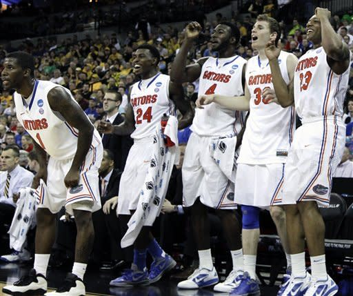 Florida players, from left, Kenny Boynton, Casey Prather, Patric Young, Erik Murphy and Bradley Beal cheer their teammates on in the final minutes of their NCAA tournament second-round college basketball game against Virginia in Omaha, Neb., Friday, March 16, 2012. Florida won 71-45. (AP Photo/Nati Harnik)