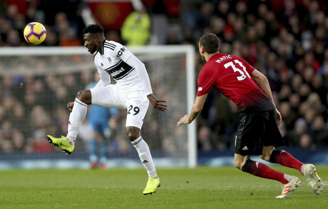Fulham's Andre-Frank Zambo Anguissa, left, and Manchester United's Nemanja Matic in action during their English Premier League soccer match at Old Trafford, Manchester, England, Saturday, Dec. 8, 2018. (Barrington Coombs/PA via AP)