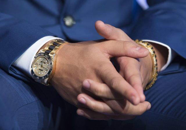 The watch of rapper Drake is seen during an announcement that the Toronto Raptors will host the 2016 NBA All-Star game in Toronto, September 30, 2013. Toronto was selected as the host of the National Basketball Association's (NBA) 2016 All-Star Game, marking the first time the showcase event will be held outside of the United States, the league said on Monday. REUTERS/Mark Blinch (CANADA - Tags: SPORT BASKETBALL ENTERTAINMENT)