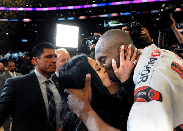 Kobe Bryant kisses his wife Vanessa after the final game of his career.