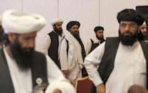 Taliban negotiators in Qatar: over two decades US experts say the Islamist insurgents, though often poorly equipped, have shown greater determination to fight than government forces