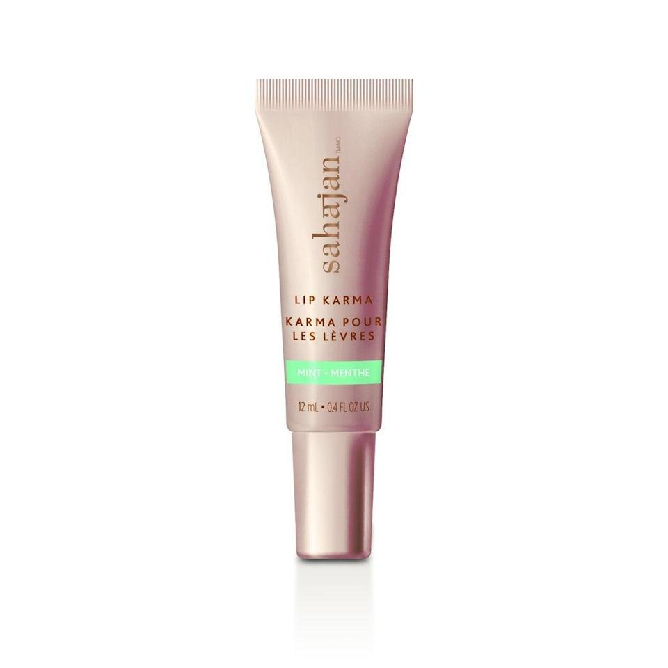 """<h3>Sahajan Lip Karma <br></h3><br>Packed with castor, grapeseed, and argan oils, this balm does your lips good by offering deep hydration and shine in a rich formula. Better yet: In partnership with <a href=""""https://plan-international.org/"""" rel=""""nofollow noopener"""" target=""""_blank"""" data-ylk=""""slk:Plan International"""" class=""""link rapid-noclick-resp"""">Plan International</a>'s <a href=""""https://plan-international.org/because-i-am-a-girl"""" rel=""""nofollow noopener"""" target=""""_blank"""" data-ylk=""""slk:Because I Am A Girl"""" class=""""link rapid-noclick-resp"""">Because I Am A Girl</a> campaign, which helps fund education for young girls worldwide, the brand donates one day of school for a girl in a developing country with each purchase.<br><br><strong>Sahajan</strong> Lip Karma, $, available at <a href=""""https://go.skimresources.com/?id=30283X879131&url=https%3A%2F%2Ffave.co%2F36QyE9h"""" rel=""""nofollow noopener"""" target=""""_blank"""" data-ylk=""""slk:Sahajan"""" class=""""link rapid-noclick-resp"""">Sahajan</a>"""