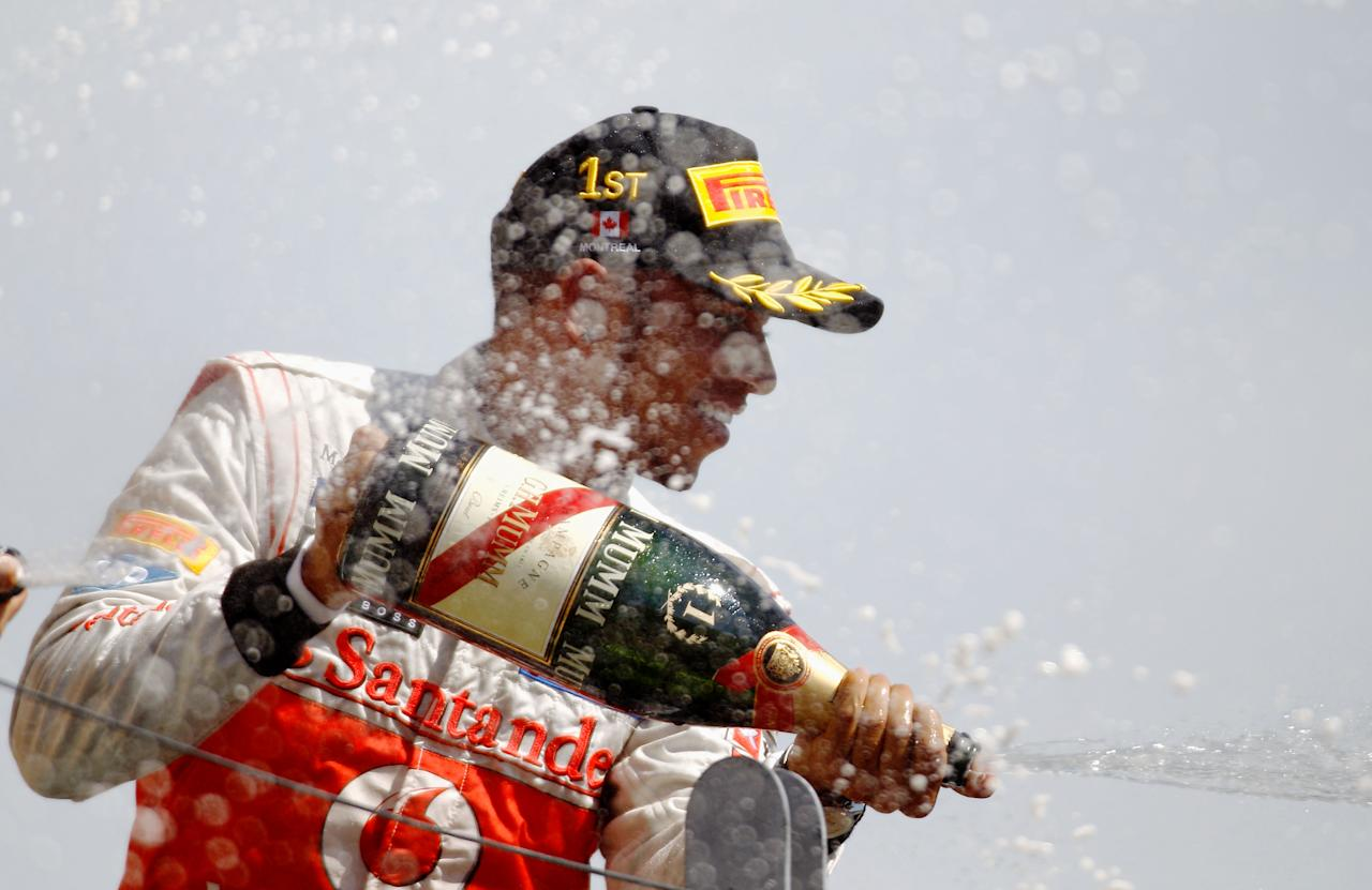 MONTREAL, CANADA - JUNE 10:  Lewis Hamilton of Great Britain and McLaren celebrates on the podium after winning the Canadian Formula One Grand Prix at the Circuit Gilles Villeneuve on June 10, 2012 in Montreal, Canada.  (Photo by Paul Gilham/Getty Images)