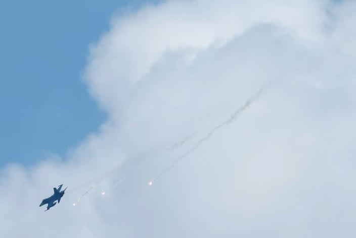 FILE PHOTO: A Taiwan domestically-built Indigenous Defense Fighter (IDF) releases flares during annual Han Kuang military drill simulating the China's People's Liberation Army (PLA) invading the island, in Pingtung county, southern Taiwan