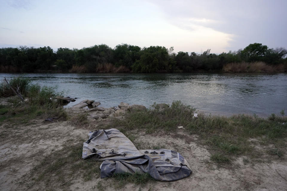 A deflated raft sits along the U.S.-Mexico border Tuesday, May 11, 2021, in Roma, Texas. The U.S. government continues to report large numbers of migrants crossing the U.S.-Mexico border with an increase in adult crossers. But families and unaccompanied children are still arriving in dramatic numbers despite the weather changing in the Rio Grande Valley registering hotter days and nights. (AP Photo/Gregory Bull)