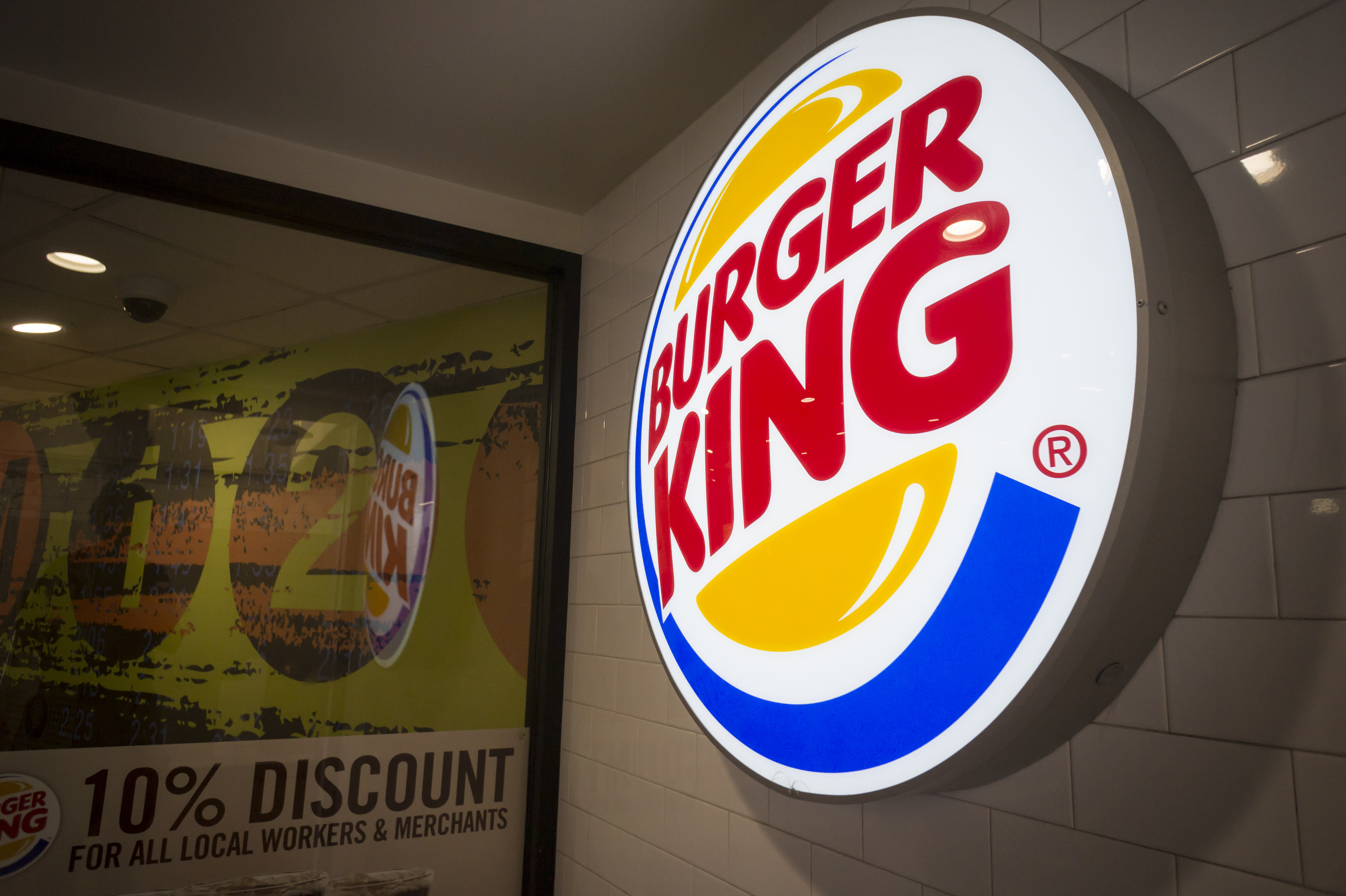 Entrance to a Burger King fast food restaurant in New York on Monday, August 25, 2014. Restaurant Brands International, the parent of Burger King and Tim Horton's, reported fourth-quarter profit that beat analysts' expectations. Innovative menu offerings including Nutella pockets are cited. (�� Richard B. Levine) (Photo by Richard Levine/Corbis via Getty Images)