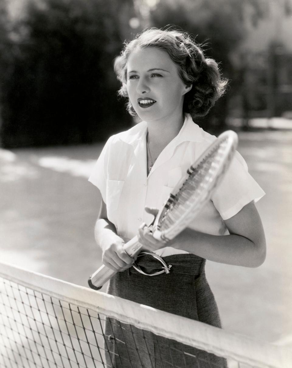 Barbara Stanwyck in action on the tennis court, 1934.