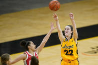 Iowa guard Caitlin Clark (22) shoots over Ohio State guard Madison Greene during overtime in an NCAA college basketball game Wednesday, Jan. 13, 2021, in Iowa City, Iowa. Clark, one of the top scorers in the nation, has been named the Big Ten's player of the week three times this season and has won the conference's freshman of the week honor six times. (AP Photo/Charlie Neibergall)