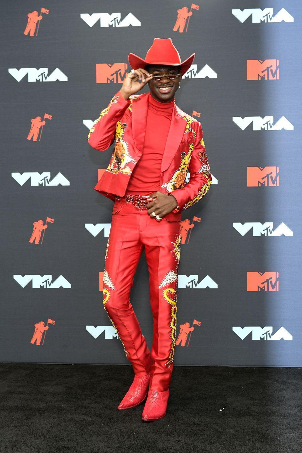 <p>At the MTV VMAs he came through in all red! The embroidery on this blazer and pants was absolutely gorgeous. Flaming Hot Cheetos could never. </p>