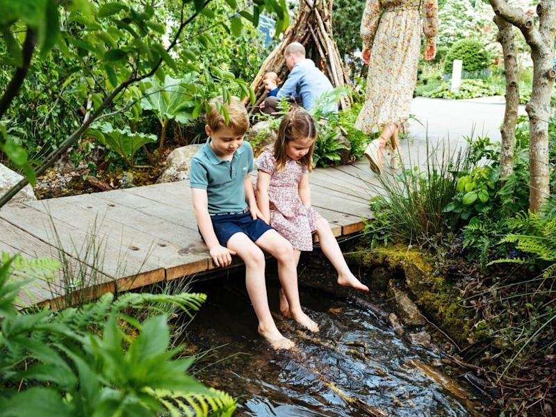 The images and footage show the royal children playing around the garden their mother co-designed. Photo: Getty Images