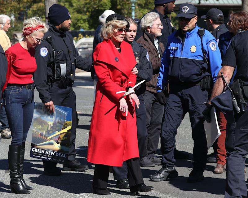 "Jane Fonda is arrested for blocking a street in front of the U.S. Capitol during a ""Fire Drill Fridays"" climate change protest and rally on Oct. 18 in Washington, D.C. (Photo: Mark Wilson via Getty Images)"