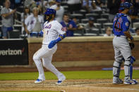New York Mets' Jonathan Villar (1) runs past Chicago Cubs catcher Willson Contreras (40) to score during the fifth inning of a baseball game Tuesday, June 15, 2021, in New York. (AP Photo/Frank Franklin II)