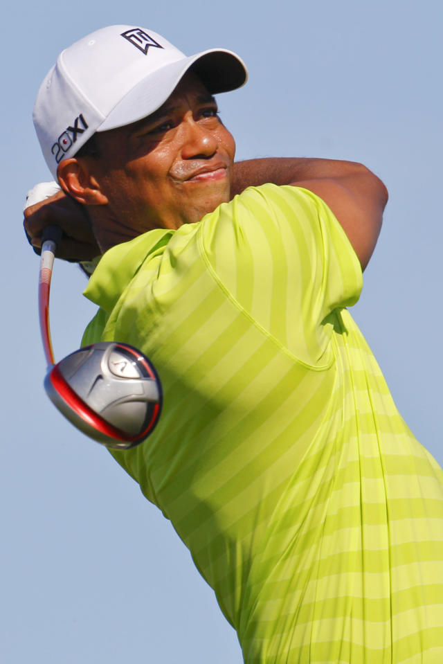 Tiger Woods watches his drive from the 15th tee during the first round of the PGA Championship golf tournament on the Ocean Course of the Kiawah Island Golf Resort in Kiawah Island, S.C., Thursday, Aug. 9, 2012. (AP Photo/Chuck Burton)