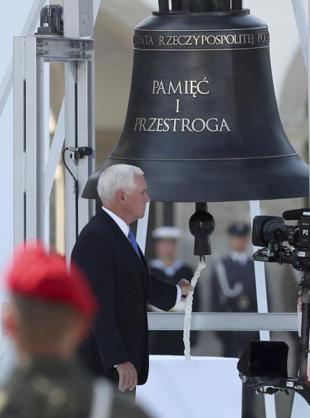 U.S. Vice President Mike Pence rings the Bell of Memory and Warning during a memorial ceremony marking the 80th anniversary of the start of World War II in Warsaw, Poland, Sunday, Sept. 1, 2019.(AP Photo/Czarek Sokolowski)