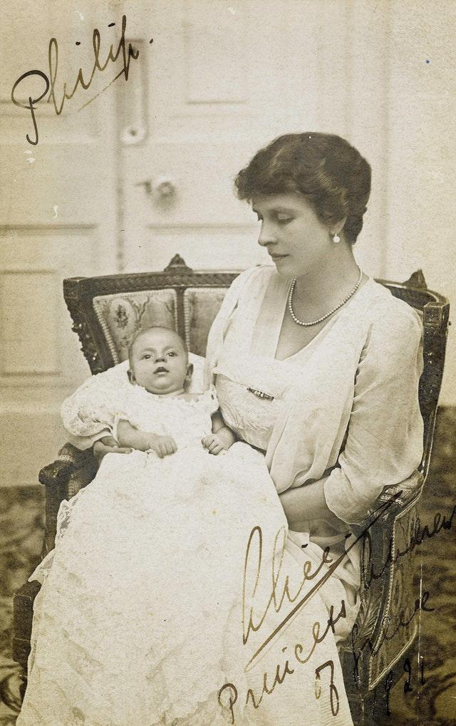Prince Philip as a baby being held by Princess Alice