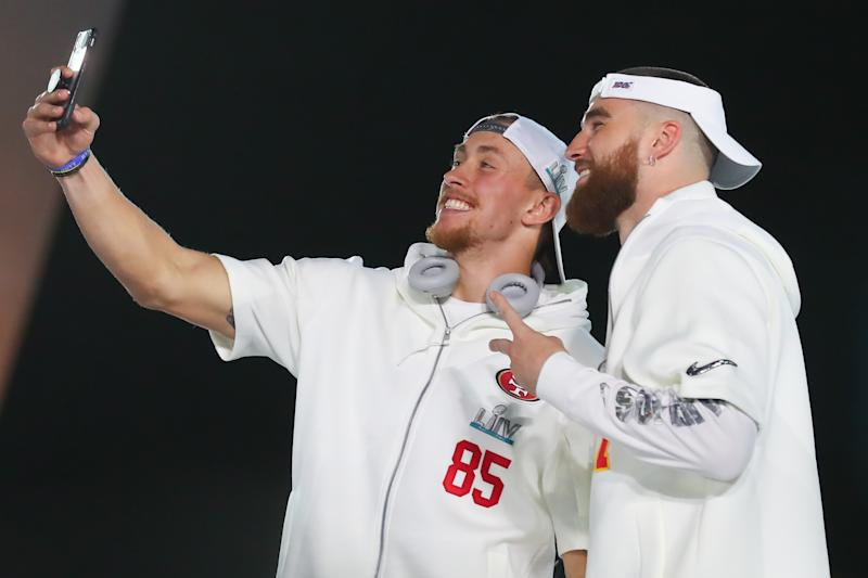 San Francisco 49ers tight end George Kittle (85) and Kansas City Chiefs tight end Travis Kelce (87) take a selfie during Super Bowl LIV Opening Night. (Photo by Rich Graessle/PPI/Icon Sportswire via Getty Images)