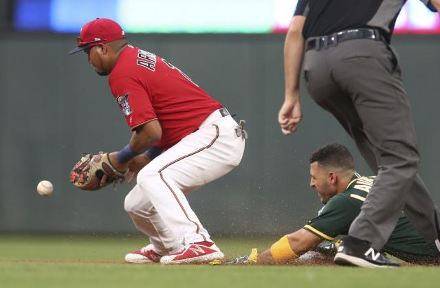 Minnesota Twins second baseman Luis Arraez, left, waits for the ball as Oakland Athletics' Ramon Laureano slides safely into second on a double in the fourth inning of a baseball game Friday, July 19, 2019, in Minneapolis. (AP Photo/Jim Mone)