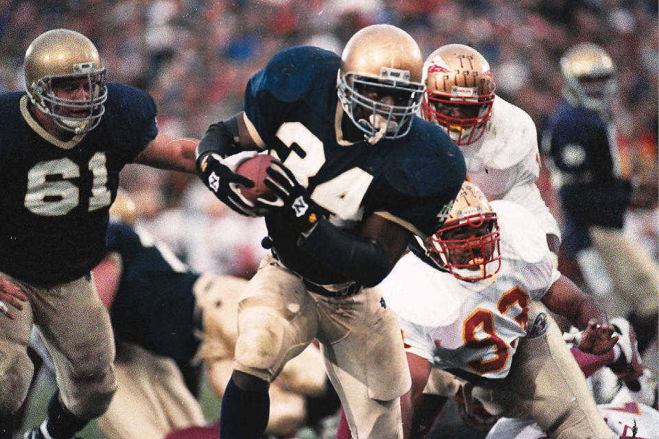 FILE - In this Nov. 13, 1993, file photo, Notre Dame back Ray Zellars (34) heads upfield during an NCAA college football game against Florida State in South Bend, Ind. The Irish won the game 31-24 and went on to lose the following week to Boston College, losing out on a national title. (AP Photo/Joe Raymond, File)