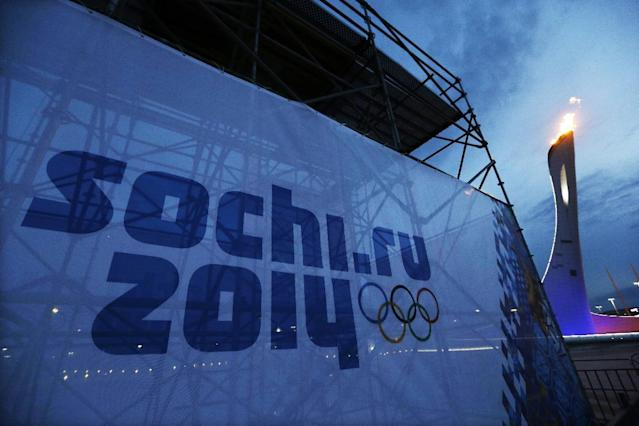 The Olympic torch is tested before the start of the 2014 Winter Olympics in the Olympic Park, Monday, Jan. 27, 2014, in Sochi, Russia. (AP Photo/David J. Phillip)