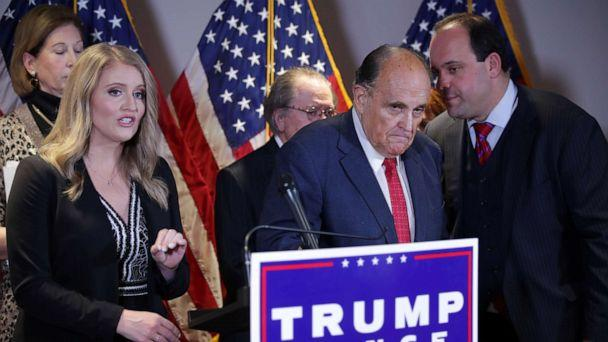 PHOTO: Trump Campaign Senior Legal Adviser Jenna Ellis speaks as Trump campaign adviser Boris Epshteyn whispers to Rudy Giuliani, personal attorney to President Donald Trump, during a news conference in Washington, Nov. 19, 2020. (Jonathan Ernst/Reuters)