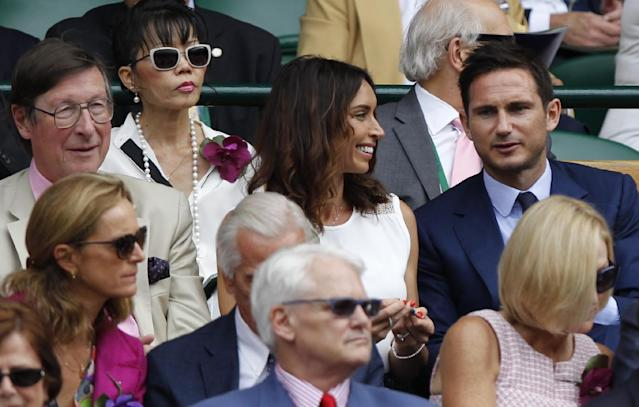 England and Chelsea soccer player Frank Lampard, right, and his girlfriend Christine Bleakley, left of him, sit in the Royal Box on centre court prior to the women's singles final between Eugenie Bouchard of Canada and Petra Kvitova of the Czech Republic at the All England Lawn Tennis Championships in Wimbledon, London, Saturday July 5, 2014. (AP Photo/Sang Tan)