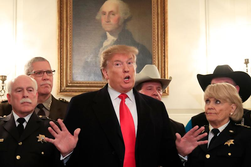 President Donald Trump speaks during a meeting with a group of sheriffs from around the country before leaving the White House in Washington, Monday, Feb. 11, 2019, for a trip to El Paso, Texas. Trump will hold his first campaign rally since November's midterm elections in El Paso,, as he faces a defining week for his push on the wall — and for his presidency and his 2020 prospects. (AP Photo/Manuel Balce Ceneta)