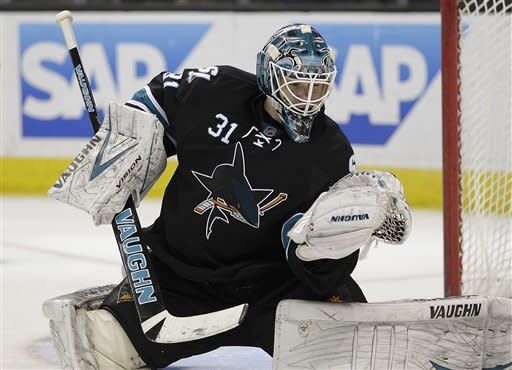 San Jose Sharks goalie Antti Niemi catches a shot from the Nashville Predators during the third period of an NHL hockey game Thursday, March 15, 2012, in San Jose, Calif. (AP Photo/Ben Margot)