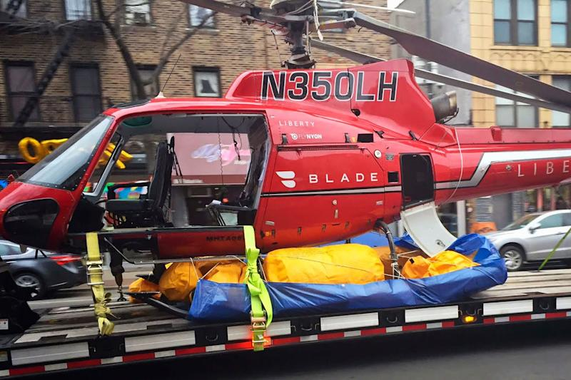 The helicopter wreckage is taken through the streets of New York after it was salvaged from the river: AP