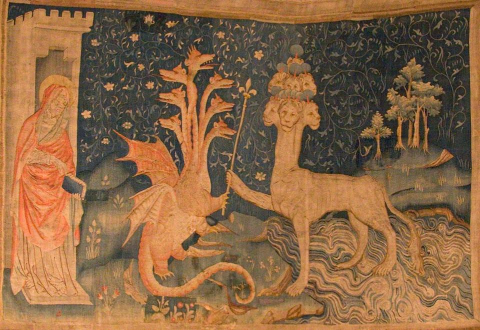 """<span class=""""caption"""">A medieval tapestry, which shows John, the Dragon and the Beast of the Sea.</span> <span class=""""attribution""""><a class=""""link rapid-noclick-resp"""" href=""""https://en.wikipedia.org/wiki/The_Beast_(Revelation)#/media/File:La_B%C3%AAte_de_la_Mer.jpg"""" rel=""""nofollow noopener"""" target=""""_blank"""" data-ylk=""""slk:Kimon Berlin, user:Gribeco, via Wikimedia Commons"""">Kimon Berlin, user:Gribeco, via Wikimedia Commons</a>, <a class=""""link rapid-noclick-resp"""" href=""""http://creativecommons.org/licenses/by-sa/4.0/"""" rel=""""nofollow noopener"""" target=""""_blank"""" data-ylk=""""slk:CC BY-SA"""">CC BY-SA</a></span>"""