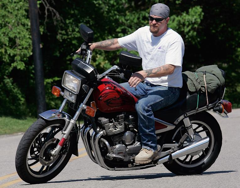 FILE - In this June 12, 2008 file photo, Randy Knauff takes off from work without a helmet on his motorcycle in Harmony, Pa. Across the nation, motorcyclists opposed to mandatory helmet use have been chipping away at state helmet laws for years while crash deaths have been on the rise. Currently, 19 states and the District of Columbia require all motorcyclists to wear a helmet, 28 states, including Pennsylvania, require only some motorcyclists _ usually younger or novice riders _ to wear a helmet, and three states have no helmet use law. States have been gradually repealing or weakening mandatory helmet laws for nearly two decades. (AP Photo/Keith Srakocic, File)