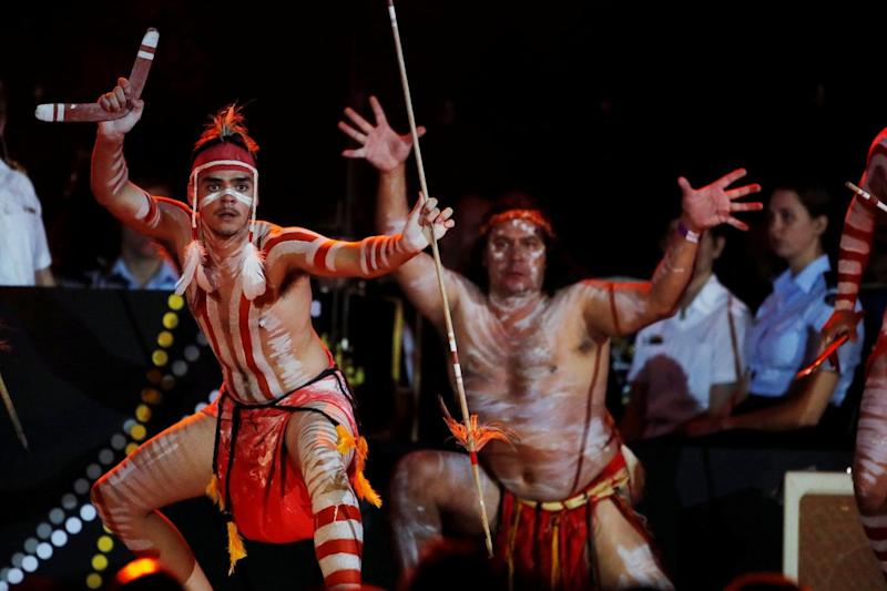 Indigenous people perform during the ceremony (REUTERS)