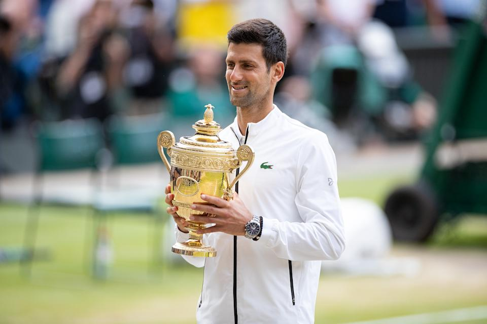 LONDON, ENGLAND - JULY 14: Novak Djokovic of Serbia with the winners trophy after defeating Roger Federer of Switzerland (not pictured)  in the Men's Singles Final  at The Wimbledon Lawn Tennis Championship at the All England Lawn and Tennis Club at Wimbledon on July 14, 2019 in London, England. (Photo by Simon Bruty/Anychance/Getty Images)